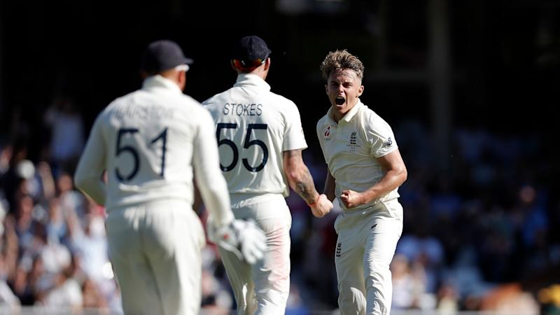 Sam Curran takes the wicket of Matthew Wade