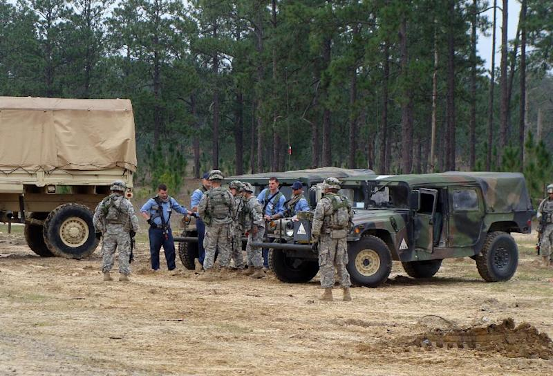 This photo taken Feb. 22, 2012 shows soldiers training at Fort Polk, La. with role players who pretend to be Afghan troops.  (AP Photo/Lolita C. Baldor)