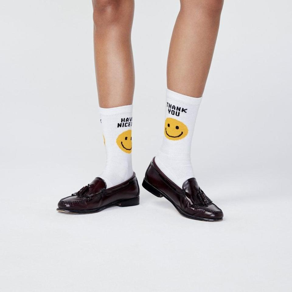 "<p>""Kule is a happy brand offering a fun, light approach to everyday pieces like socks and tees. I love that these <span>Take Out Socks</span> ($28) add a little uplifting wink to your look.""</p>"