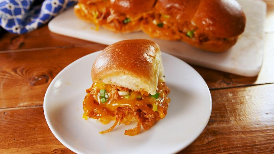 """<p>The sandwich version of your fave Mexican dish.</p><p>Get the recipe from <a href=""""https://www.delish.com/cooking/recipe-ideas/a25846185/chicken-enchilada-sliders-recipe/"""" rel=""""nofollow noopener"""" target=""""_blank"""" data-ylk=""""slk:Delish"""" class=""""link rapid-noclick-resp"""">Delish</a>.</p>"""