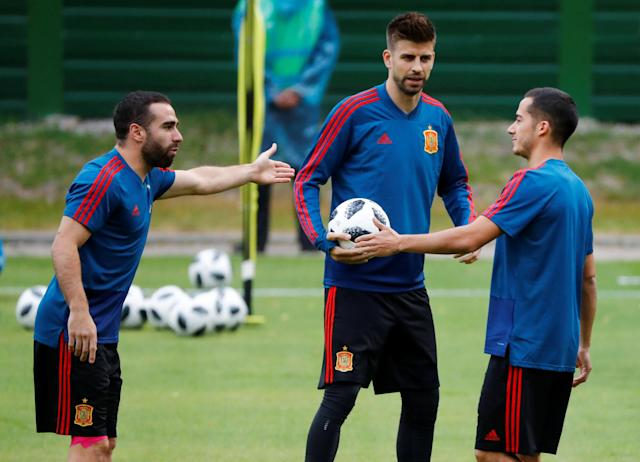 Soccer Football - World Cup - Spain Training - Spain Training Camp, Kaliningrad, Russia - June 24, 2018 Spain's Gerard Pique and team mates during training REUTERS/Fabrizio Bensch