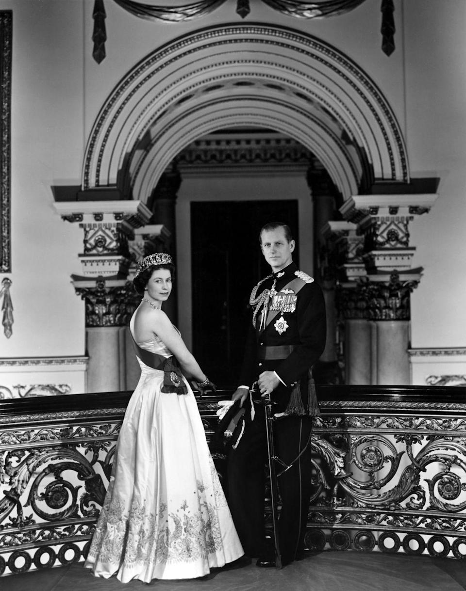 <p>Queen Elizabeth II and Prince Philip pose for a portrait at home in Buckingham Palace in December 1958.</p>