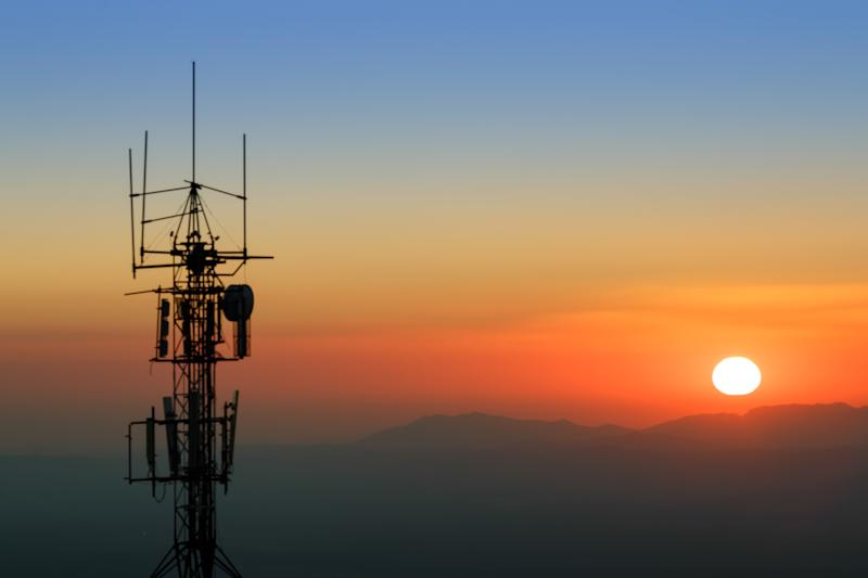 Communication tower backlit at sunset. With mountain range in the background. In the Sierra Nevada National Park, province of Granada, Spain.
