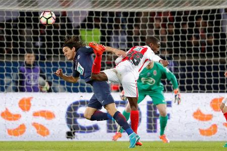Soccer Football - Paris Saint Germain v AS Monaco - French Cup Semi-Final - Parc des Princes stadium, Paris, France - 26/04/2017. Edinson Cavani of Paris Saint Germain in action against Safwan Mbae of AS Monaco. REUTERS/Charles Platiau