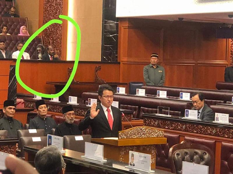 Those present at today's swearing-in ceremony said the so-called 'ghost' (circled in green) was a guest of Minister in the Prime Minister's Department P. Waytha Moorthy.