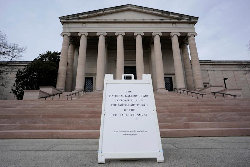 FILE PHOTO: A closing sign is seen outside the National Gallery of Art in Washington, U.S., before it will be reopen next week after partial government shutdown, January 27, 2019. REUTERS/Yuri Gripas