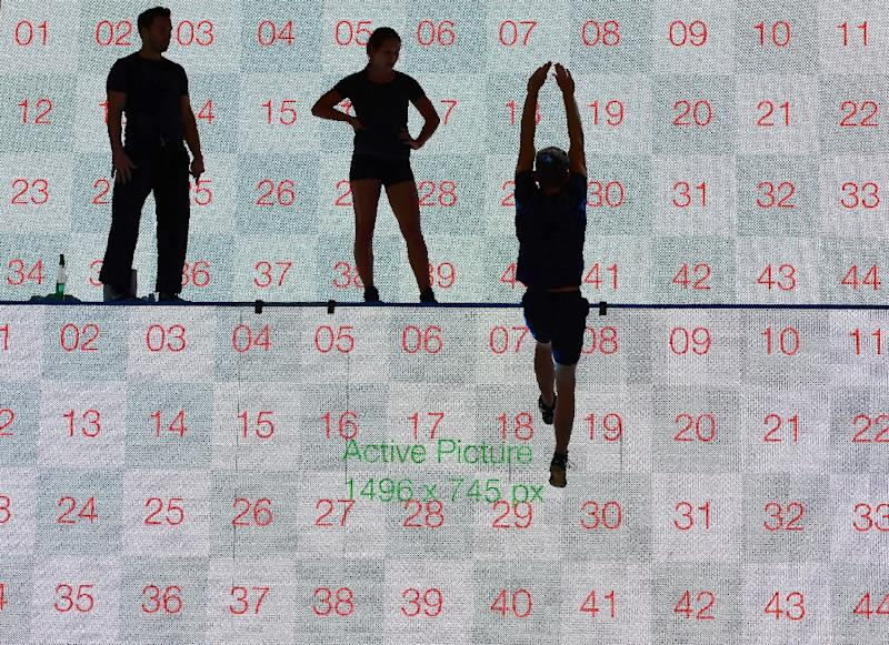 Artists perform in front of a screen at the Busch-Jaeger booth at the IFA electronics trade fair in Berlin (AFP Photo/Tobias Schwarz)