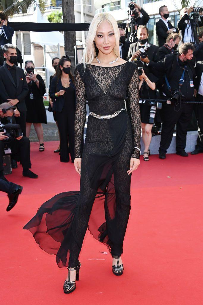 <p>The model and DJ wore a Chanel, lace bodysuit and overlay dress to the red carpet.</p>