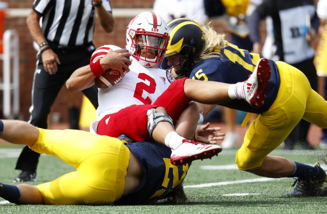 Michigan linebacker Jordan Glasgow (29) sacks Nebraska quarterback Adrian Martinez (2) as Chase Winovich (15) assists in the first half of an NCAA football game in Ann Arbor, Mich., Saturday, Sept. 22, 2018. (AP Photo/Paul Sancya)