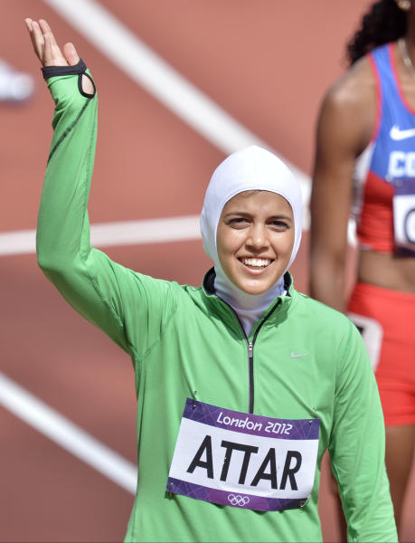 Saudi Arabia's Sarah Attar waves before competing in a women's 800-meter heat during the athletics in the Olympic Stadium at the 2012 Summer Olympics, London, Wednesday, Aug. 8, 2012. Attar is the first Saudi woman to compete in athletics during the Olympics.(AP Photo/Martin Meissner)