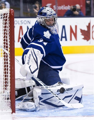 Toronto Maple Leafs goalie James Reimer makes a pad save against the Washington Capitals during the first period of an NHL hockey game in Toronto on Thursday, Jan. 31, 2013. (AP Photo/The Canadian Press, Nathan Denette)