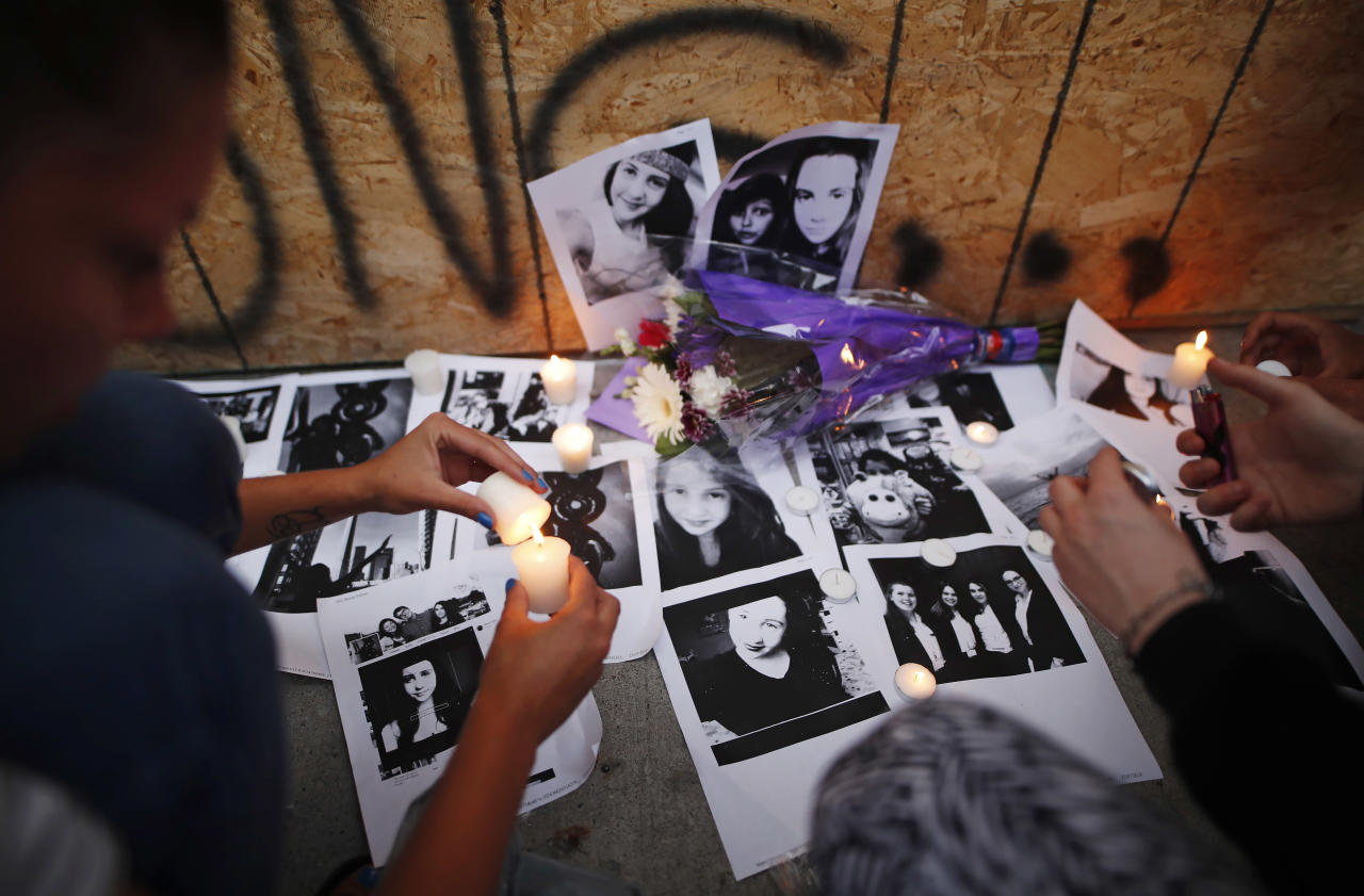 <p>People light candles and leave photos of 18-year-old victim Reese Fallon at a memorial remembering the victims of Sunday's shooting in Toronto on Monday, July 23, 2018. (Photo: Mark Blinch/The Canadian Press via AP) </p>