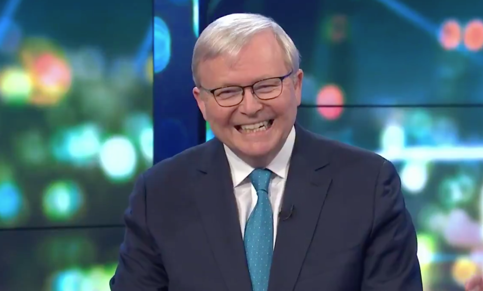 A close up of Mr Rudd in a blue tie laughing.
