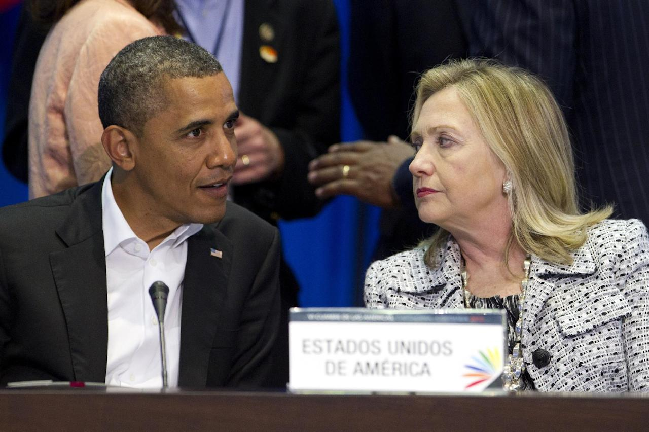 President Barack Obama, left, and Secretary of State Hillary Rodham Clinton attend the plenary session of the sixth Summit of the Americas in Cartagena, Colombia, Saturday April 14, 2012. The summit brings together presidents and prime ministers from Canada, the Caribbean, Latin America and the U.S. (AP Photo/Carolyn Kaster)
