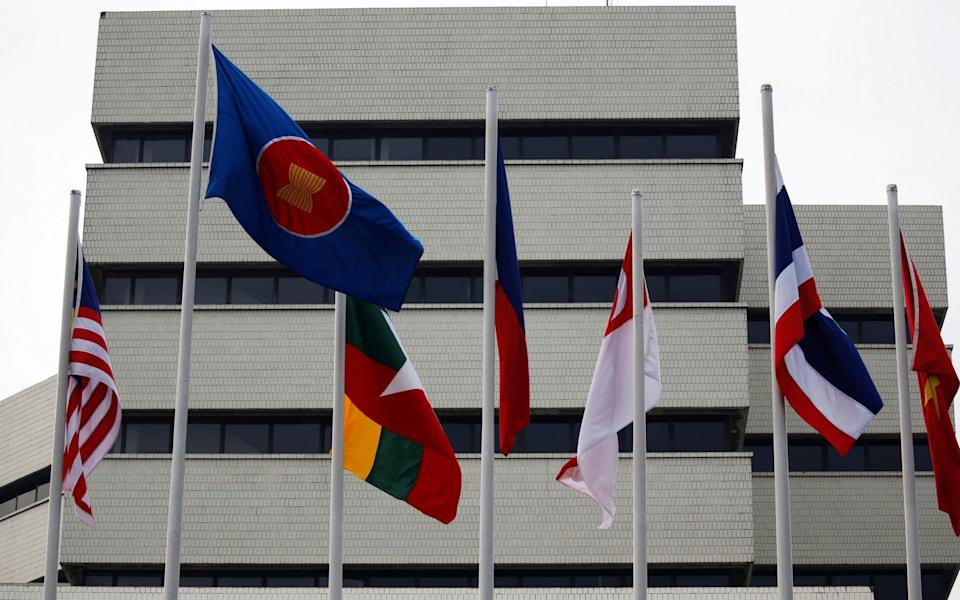 Flags are seen outside the Association of Southeast Asian Nations (ASEAN) secretariat building in Jakarta, Indonesia - WILLY KURNIAWAN/REUTERS