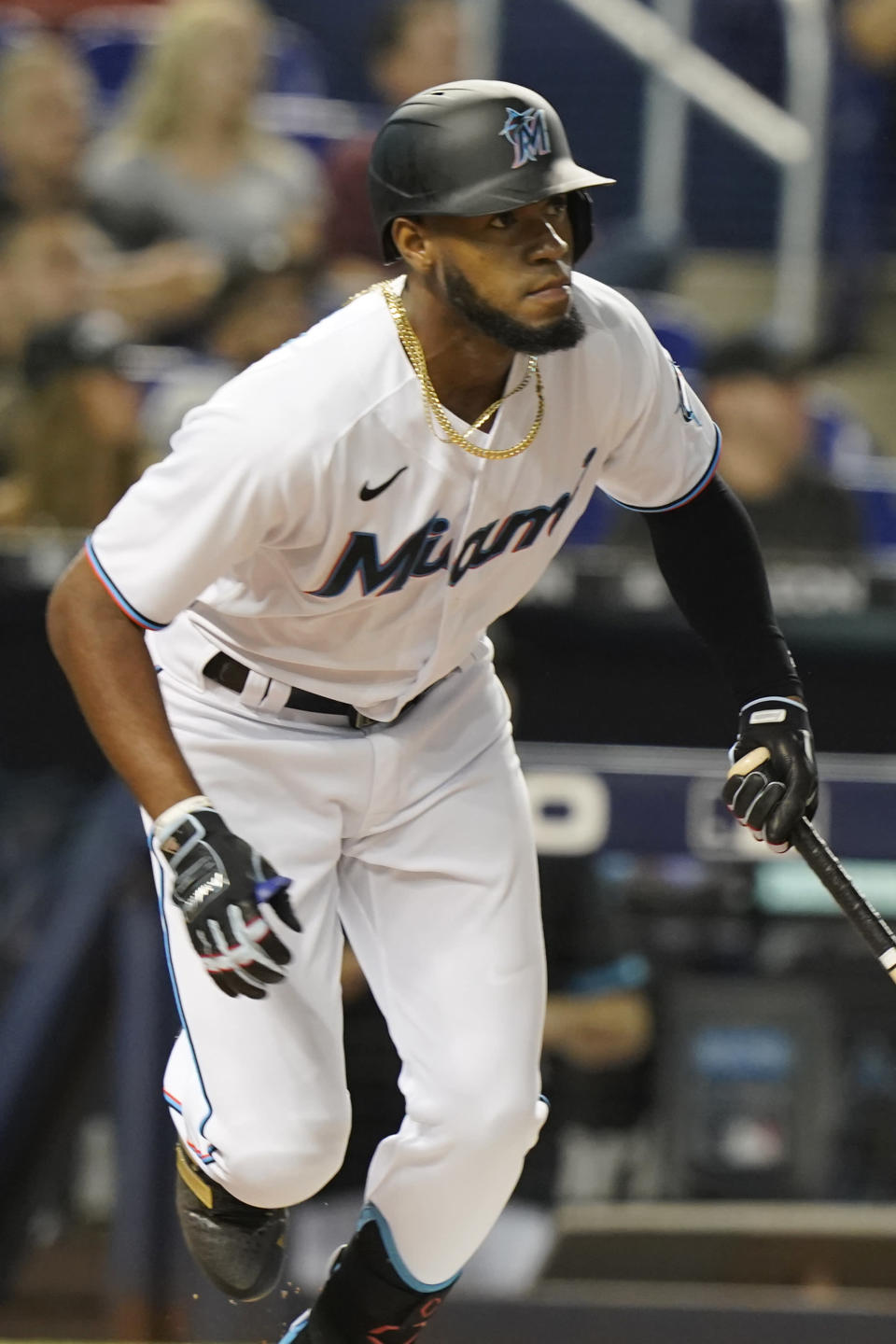 Miami Marlins' Bryan De La Cruz watches his hit during the first inning of a baseball game against the Washington Nationals, Tuesday, Sept. 21, 2021, in Miami. (AP Photo/Marta Lavandier)