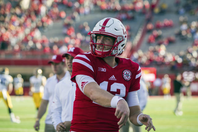 "Nebraska quarterback <a class=""link rapid-noclick-resp"" href=""/ncaaf/players/241199/"" data-ylk=""slk:Tanner Lee"">Tanner Lee</a> (13) throws a pass during warm-ups before an NCAA college football game against Iowa in Lincoln, Neb., Friday, Nov. 24, 2017. (AP Photo/John Peterson)"