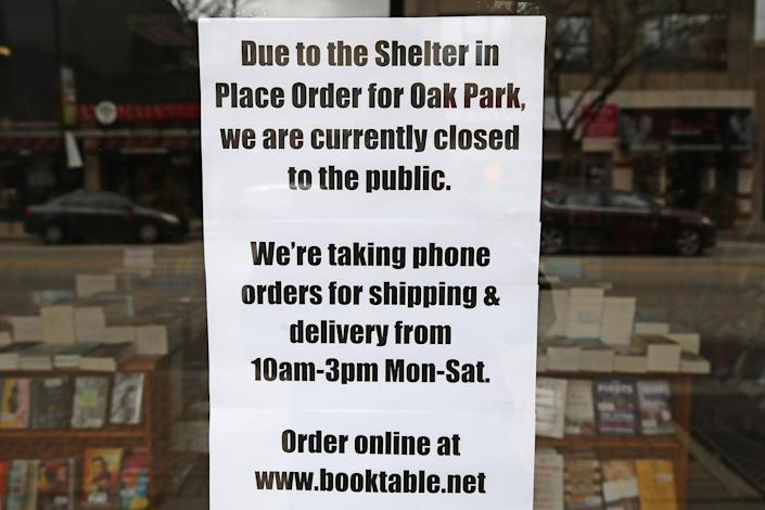 An independent bookstore in Oak Park, Illinois put up this sign as authorities in the state tried to stop the spread of the virus: Jonathan Daniel/Getty Images