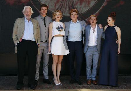 """Cast members Donald Sutherland, Liam Hemsworth, Jennifer Lawrence, Sam Claflin, Josh Hutcherson and Julianne Moore pose during a photocall for the film """"The Hunger Games : Mockingjay - Part 1"""" at the 67th Cannes Film Festival in Cannes"""