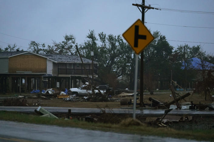 Debris, still not picked up from Hurricane Laura, lies piled up in advance of Hurricane Delta, expected to make landfall Friday, in Cameron, La., Thursday, Oct. 8, 2020. (AP Photo/Gerald Herbert)