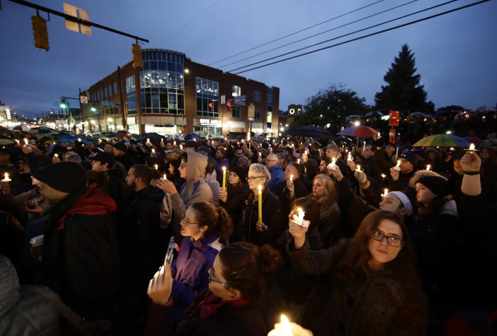 """<span class=""""s1"""">A crowd gathers for a candlelight vigil in Saturday night in the Squirrel Hill neighborhood of Pittsburgh. (Photo: Matt Rourke/AP)</span>"""