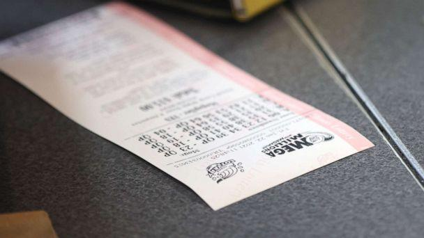 PHOTO: A customer purchases a Mega Millions lottery ticket in Chicago, Jan. 22, 2021. (Scott Olson/Getty Images, FILE)