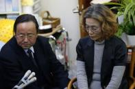 Junko Ishido, mother of Kenji Goto, who is a Japanese journalist being held captive by Islamic State militants, listens to questions from reporters at her house in Tokyo January 28, 2015. REUTERS/Yuya Shino