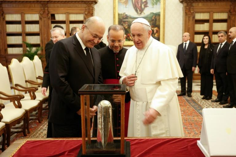 Pope Francis exchanges gifts with Iraqi President Barham Salih at the end of a private audience at the Vatican in January last year