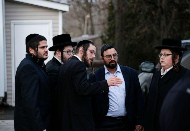 PHOTO: Members of the Jewish community gather outside the home of rabbi Chaim Rottenberg in Monsey, N.Y., Dec. 29, 2019, after an attack that took place earlier outside the rabbi's home during Hanukkah. (Kena Betancur/AFP/Getty Images)