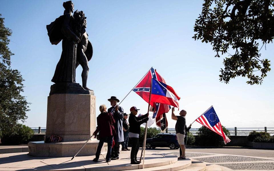 Members of a group called Flags of the South hold a protest in front of The Confederate Defenders of Charleston statue at The Battery Charleston, South Carolina - AFP