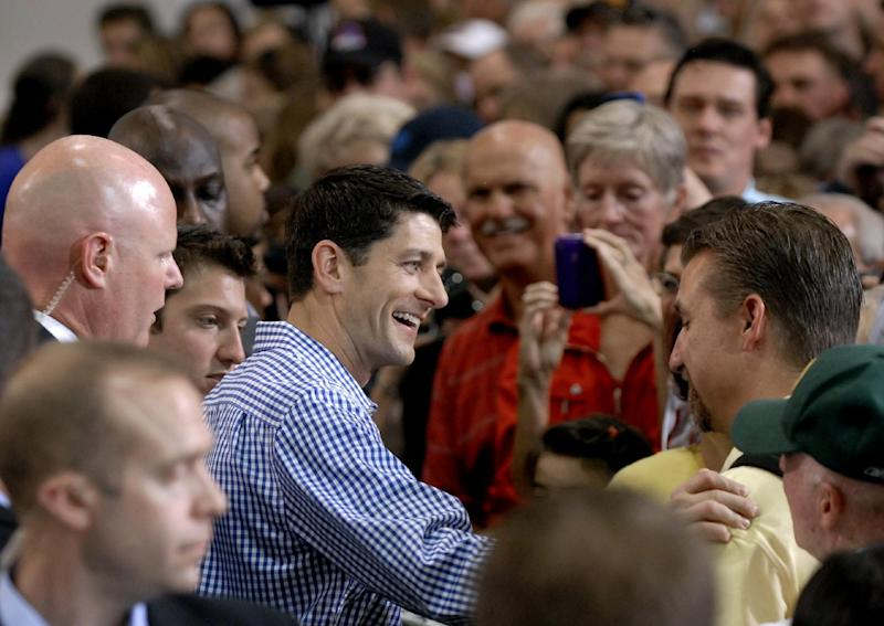Republican vice presidential candidate, Rep. Paul Ryan, R-Wis. greets supporters at WestPac Restorations in Colorado Springs, Colo., Thursday, Sept. 6, 2012. (AP Photo/Bryan Oller)