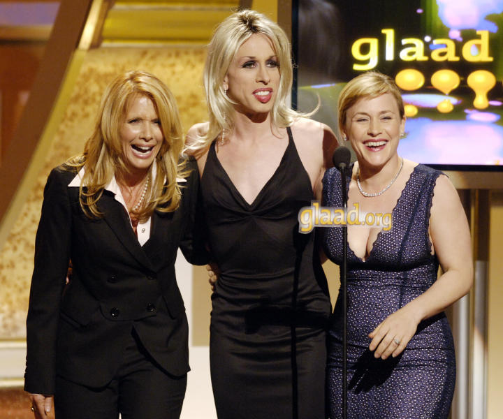 FILE - In this April 8, 2006 file photo, acting siblings Rosanna Arquette, from left, Alexis Arquette, center, Patricia Arquette present an award at the 17th annual Gay and Lesbian Alliance Against Defamation Media Awards in Los Angeles. Alexis Arquette, the transgender character actress and sibling of actors David, Rosanna, Richmond and Patricia Arquette, died early Sunday, Sept. 11, 2016 in Los Angeles. She was 47. (AP Photo/Chris Pizzello, File)