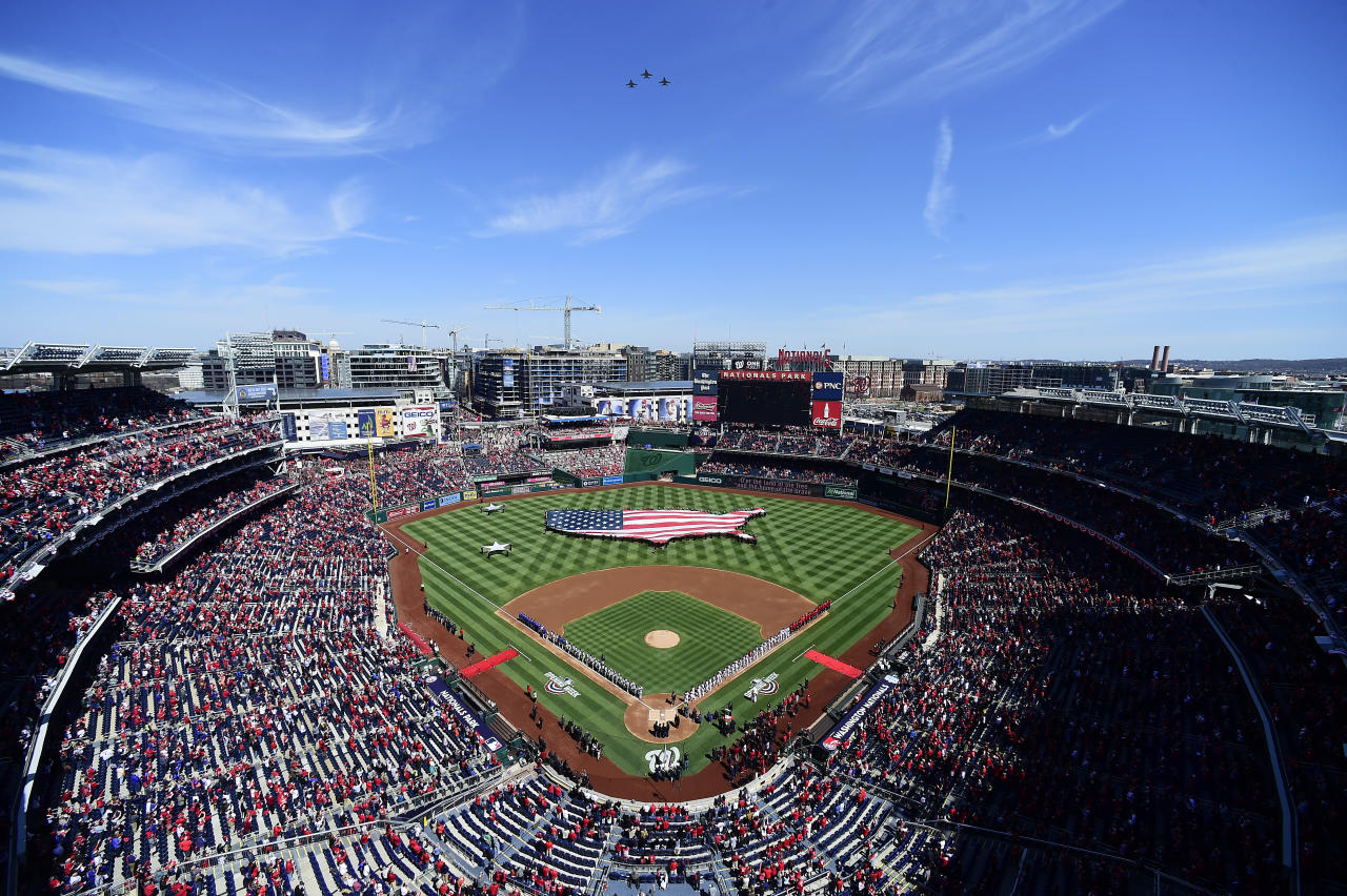 A general view as members of the New York Mets and Washington Nationals line the baselines as they listen to the playing of the national anthem on Opening Day at Nationals Park on March 28, 2019, in Washington, D.C. (Photo: Patrick McDermott/Getty Images)