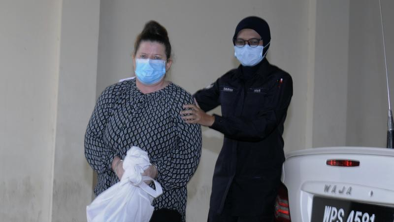 British woman in Malaysia court for trial in husband's death