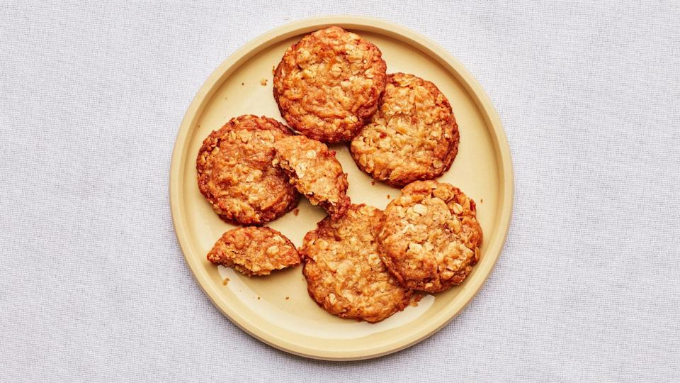 """<a href=""""https://www.bonappetit.com/recipe/anzac-biscuits?mbid=synd_yahoo_rss"""" rel=""""nofollow noopener"""" target=""""_blank"""" data-ylk=""""slk:See recipe."""" class=""""link rapid-noclick-resp"""">See recipe.</a>"""
