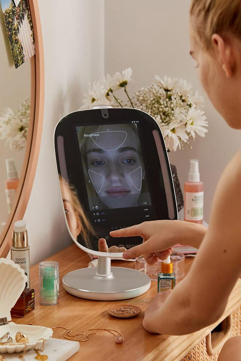 """<p>Bad Zoom lighting? Not in this house. This smart mirror provides the perfect light and magnification for makeup-application needs. Even cooler, it analyzes your complexion and reports back to you on any changes. </p> <p><strong>Buy It!</strong> HiMirror Smart Beauty Mirror, $199.00; <a href=""""https://click.linksynergy.com/deeplink?id=93xLBvPhAeE&mid=43176&murl=https%3A%2F%2Fwww.urbanoutfitters.com%2Fshop%2Fhimirror-smart-beauty-mirror%3Fcolor%3D007%26amp%3Btype%3DREGULAR%26amp%3Bsize%3DONE%2BSIZE%26amp%3Bquantity%3D1&u1=PEO2020HolidayGiftGuideGiftsEveryTechLoverNeedsThisSeasonawurzburTecGal12384134202011I"""" rel=""""nofollow noopener"""" target=""""_blank"""" data-ylk=""""slk:urbanoutfitters.com"""" class=""""link rapid-noclick-resp"""">urbanoutfitters.com</a></p>"""