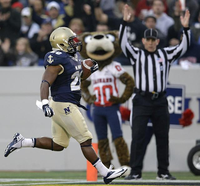 Navy running back Darius Staten runs into the end zone for a touchdown in the first half of an NCAA college football game against South Alabama in Annapolis, Md., Saturday, Nov. 16, 2013. (AP Photo/Patrick Semansky)