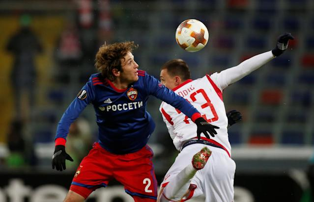 Soccer Football - Europa League Round of 32 Second Leg - CSKA Moscow vs Red Star Belgrade - VEB Arena, Moscow, Russia - February 21, 2018 CSKA Moscow's Mario Fernandes in action with Red Star Belgrade's Milan Rodic REUTERS/Maxim Shemetov