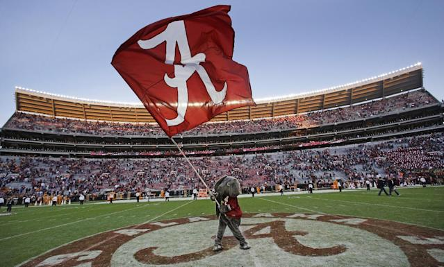 Alabama mascot Big Al waves an Alabama flag following a 45-10 win over Tennessee in an NCAA college football game in Tuscaloosa, Ala., Saturday, Oct. 26, 2013. (AP Photo/Dave Martin)
