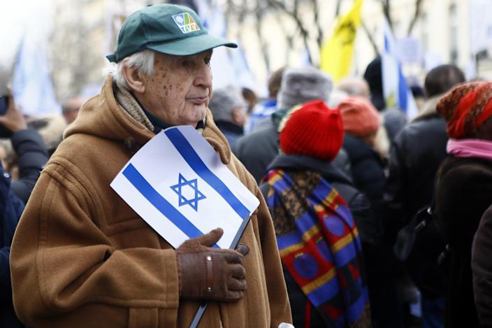 A man holding an Isreali flag listens to speeches as pro-Israel demonstrators gather in front of Israel embassy in Paris, France, Sunday, Jan. 15, 2017. Fearing a new eruption of violence in the Middle East, more than 70 world diplomats gathered in Paris on Sunday to push for renewed peace talks that would lead to a Palestinian state. (AP Photo/Francois Mori)