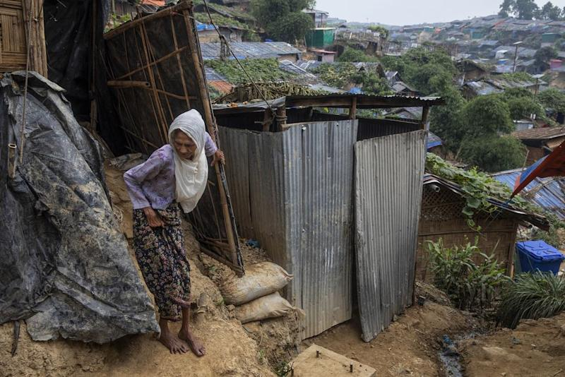 Most of the camps are built on steep hills, making walking difficult even in the dry season. | James Nachtwey for TIME