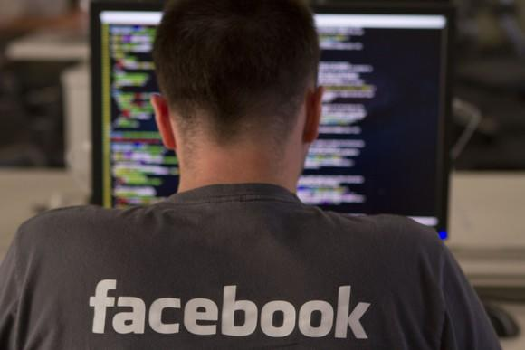 A Facebook engineer writing code on his computer.