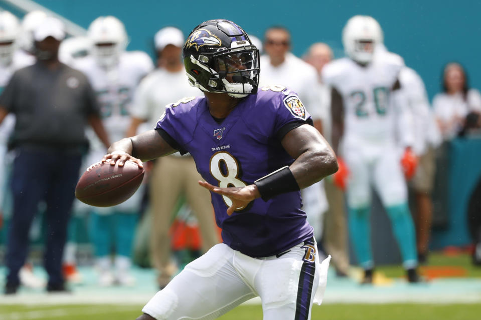 Baltimore Ravens quarterback Lamar Jackson (8) looks to pass, during the first half at an NFL football game against the Miami Dolphins, Sunday, Sept. 8, 2019, in Miami Gardens, Fla. (AP Photo/Wilfredo Lee)
