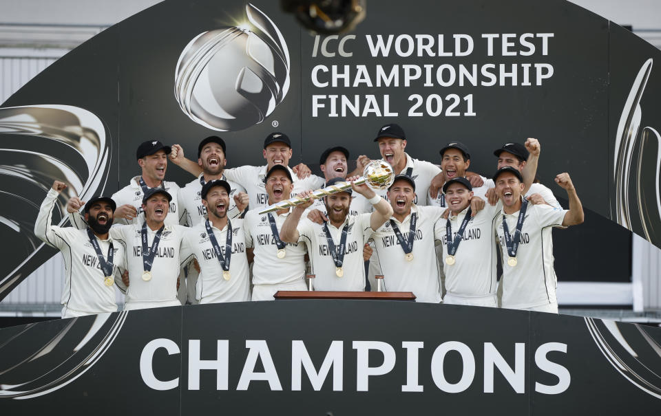 Cricket - ICC World Test Championship Final - India v New Zealand - Rose Bowl, Southampton, Britain - June 23, 2021 New Zealand's Kane Williamson celebrates with the trophy and teammates after winning the final to become the ICC World Test Champions Action Images via Reuters/John Sibley