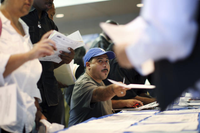 Job seekers fill out applications during the 11th annual Skid Row Career Fair at the Los Angeles Mission in Los Angeles, California, May 31, 2012. U.S. jobs growth probably snapped back in May from weather-related distortions that had slowed hiring, suggesting the economy was still expanding moderately despite strong headwinds from Europe. REUTERS/David McNew (UNITED STATES - Tags: BUSINESS EMPLOYMENT)