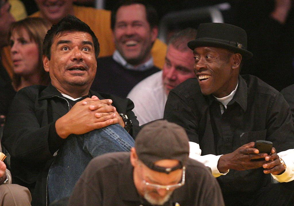 Nearby, former talk show host George Lopez kept actor Don Cheadle entertained. The duo were probably also happy about the game's final score: the Lakers beat the Mavericks 73-70. (01/16/2012)