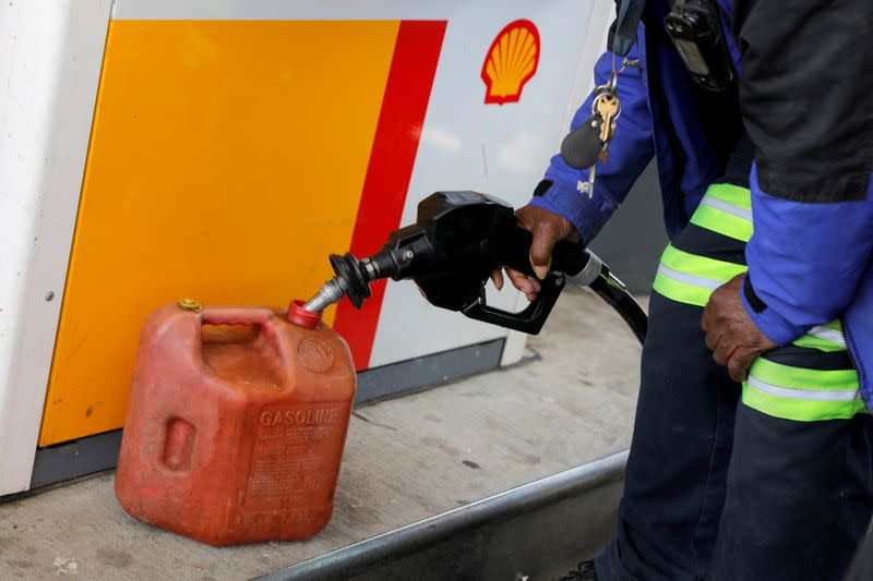 FILE PHOTO: A person fills a fuel container at a Shell gas station, after a cyberattack crippled the biggest fuel pipeline in the country, run by Colonial Pipeline, in Washington, D.C.