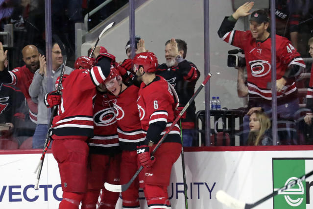 Carolina Hurricanes' Andrei Svechnikov (37) of Russia, center, celebrates his goal with Jordan Staal (11), left, and Joel Edmundson (6) during the first period of an NHL hockey game against the San Jose Sharks in Raleigh, N.C., Thursday, Dec. 5, 2019. (AP Photo/Chris Seward)