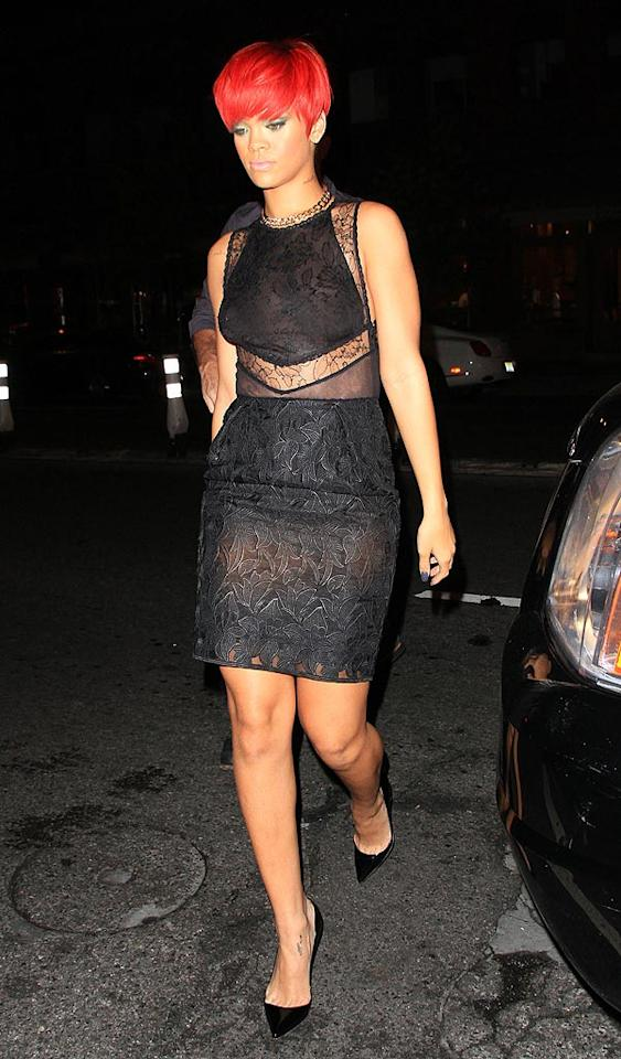 "The Barbadian beauty was snapped again after her NYC concert Thursday sporting a saggy lace dress and her new ""Rebelle Fleur"" neck tattoo. While an adjective typically follows a noun in French, RiRi insists her tattoo is grammatically correct. She reportedly sent the following text to her tattoo artist: ""rebelle fleur translates to rebel flower, NOT rebelious flower, its 2 nouns so in that case fleur does not HAVE to be first! Fyi, cuz they will ask."" Jackson Lee/<a href=""http://www.splashnewsonline.com/"" target=""new"">Splash News</a> - August 12, 2010"