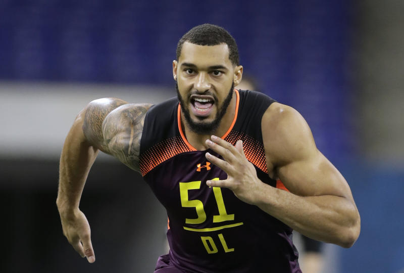 FILE - In this March 3, 2019, file photo, Mississippi State defensive lineman Montez Sweat runs a drill during the NFL football scouting combine, in Indianapolis. Sweat is a possible pick in the 2019 NFL Draft. (AP Photo/Darron Cummings, File)